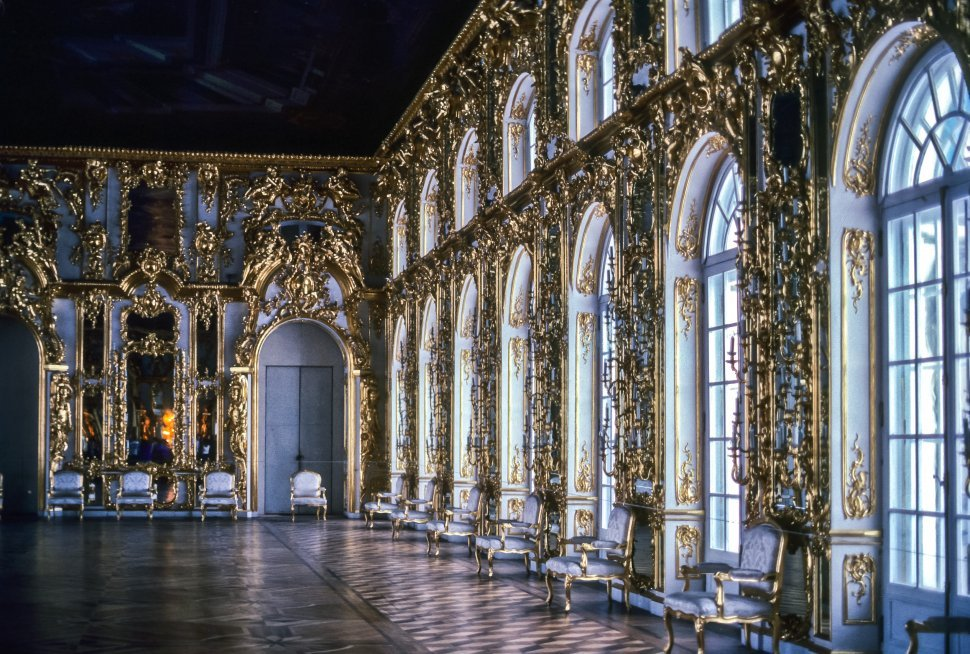 Free image of Ornate palace ballroom with chairs lining the walls, Russia