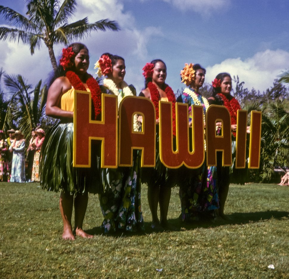 Free image of Group of women in traditional clothing welcoming tourists, Hawaii, USA