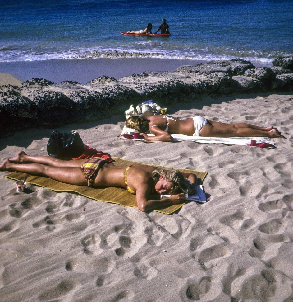 Free image of Two women sunbathing on the beach, Hawaii, USA
