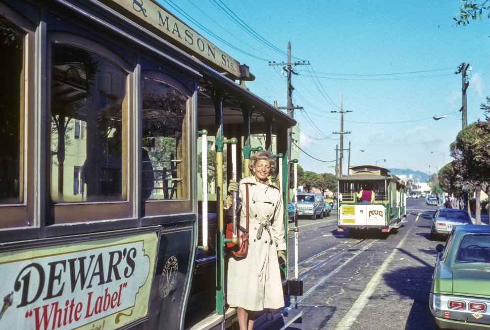 Free image of Woman stepping of a trolley car, San Francisco, California, USA