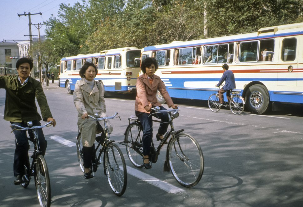 Free image of Three people commuting on bicycles, China