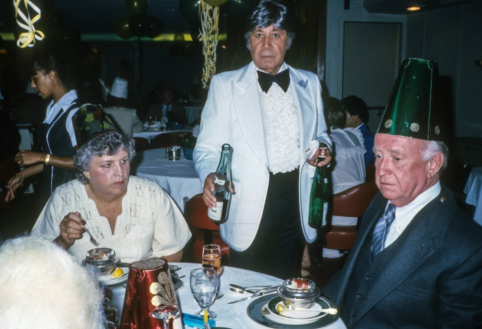 Free image of Waiter serving a couple drinks at a dinner celebration, Europe