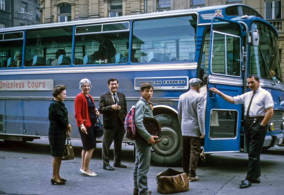 Free image of Group of tourists boarding a tour bus, Europe