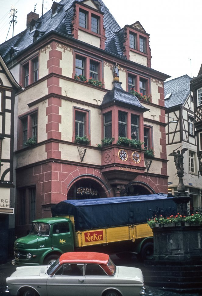 Free image of Vintage car and truck parked in front of a traditional German building, Germany