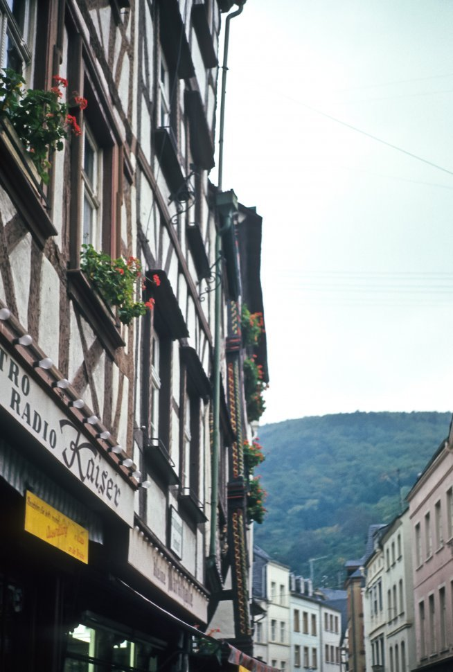 Free image of Buildings and signs along a narrow street, Germany