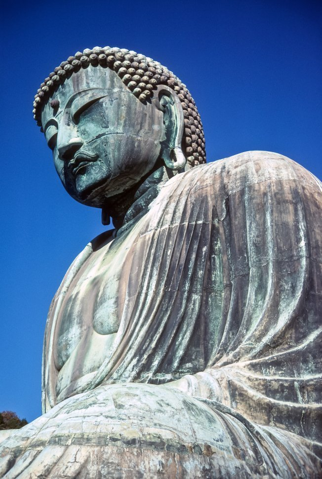 Free image of Image of an ancient stone carving of a seated Buddha, Asia