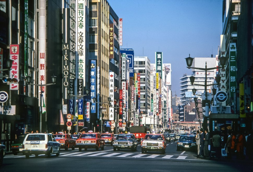 Free image of Crowded city street surrounded by large advertisments, Asia