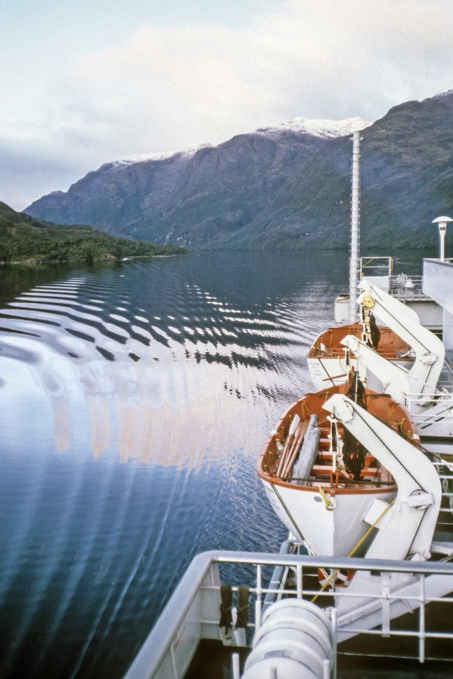 Free image of Lifeboats hanging from the side of a cruise ship over the water, Alaska, USA