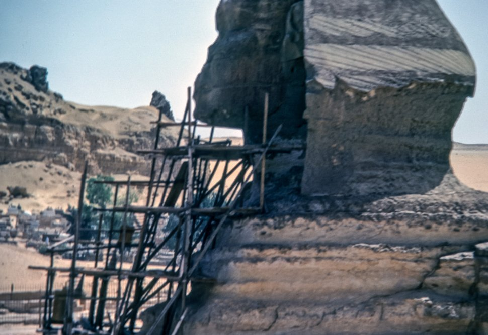 Free image of Scaffolding behind a large ruin in the desert, Egypt
