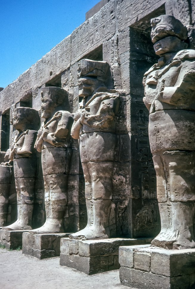 Free image of Ancient Egyptian statues carved into stone columns, Egypt