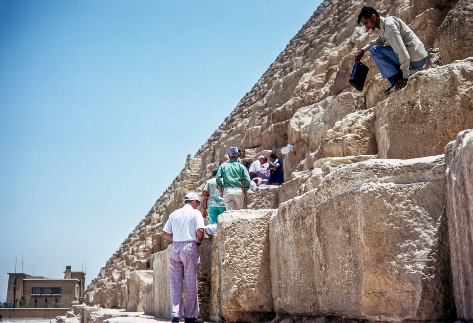 Free image of Tourists climbing huge stones on the Great Pyramid, Egypt