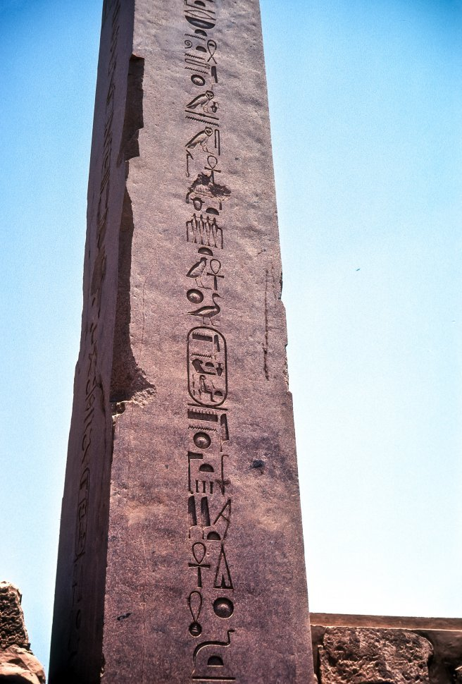 Free image of Ancient Egyptian hieroglyphics carved into a stone column, Egypt
