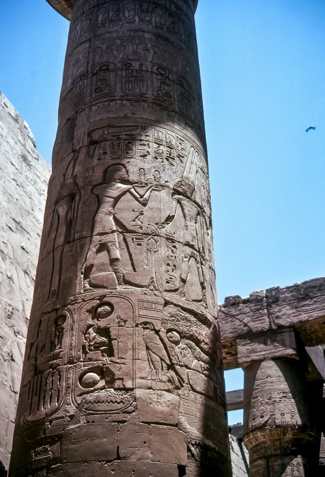Free image of Ancient Egyptian symbols carved into a stone column, Egypt