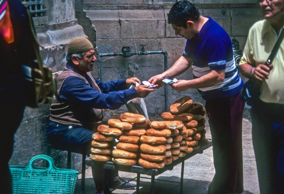 Free image of Man buying bread from another man in the market, Egypt