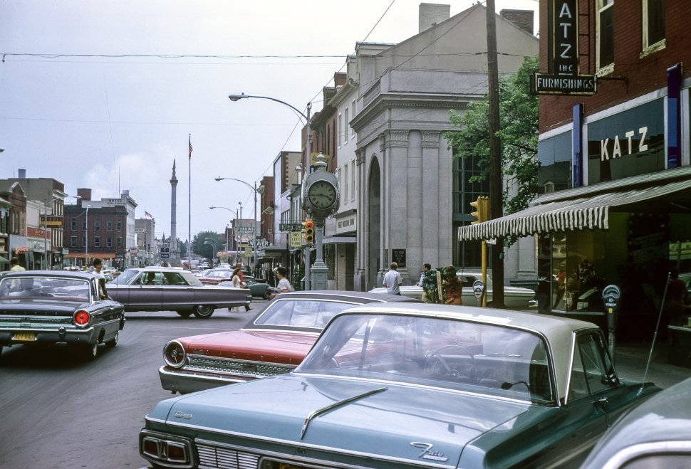 Free image of Main drag of a classic Lewistown, PA with vintage cars and people walking around, USA
