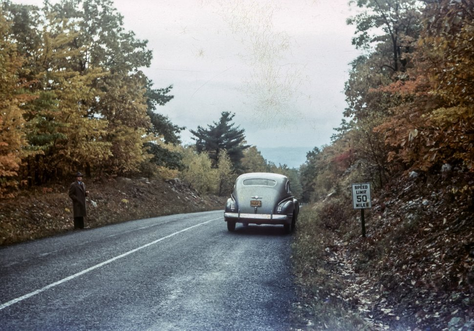 Free image of Man and a car parked on the side of the road, USA