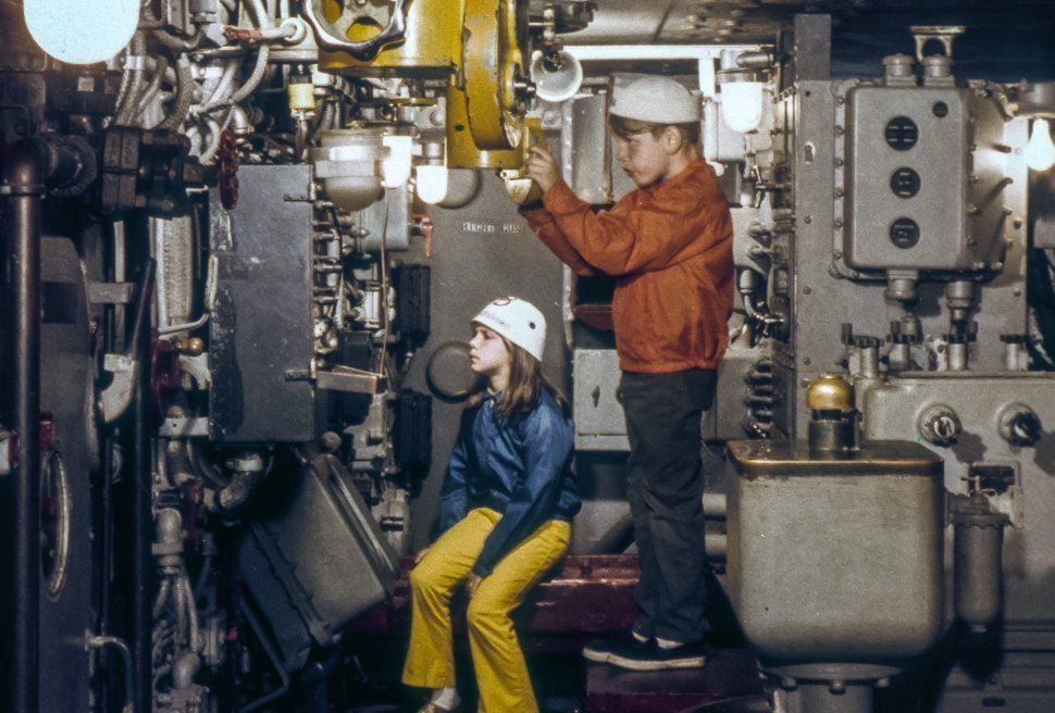 Free image of Girl and a boy playing on a submarine, USA