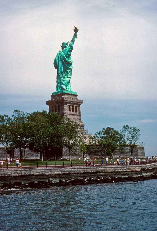 Free image of Image of the back of the Staue of Liberty and tourists, New York, New York, USA
