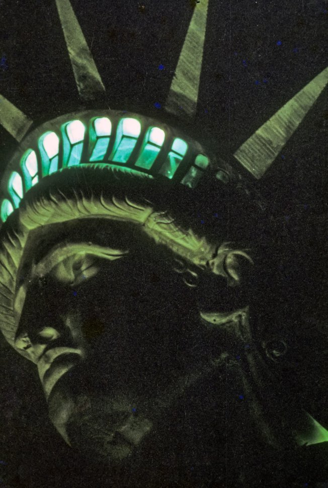Free image of Close up of the Staue of Liberty s crown lit at night, New York, New York, USA