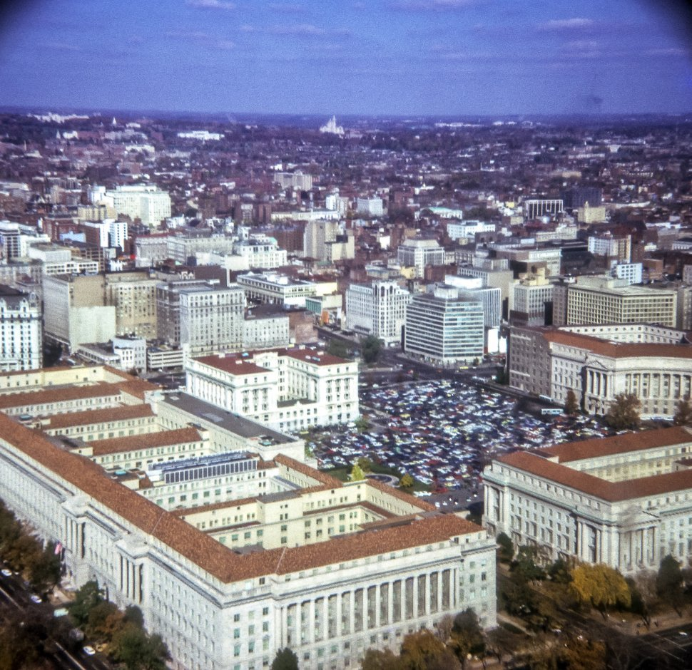 Free image of Aerial view of a city with large buildings and a square, vignetting at the edge of image.