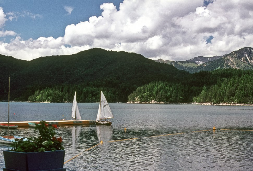Free image of Sailboat on the lake below snow capped mountains, USA
