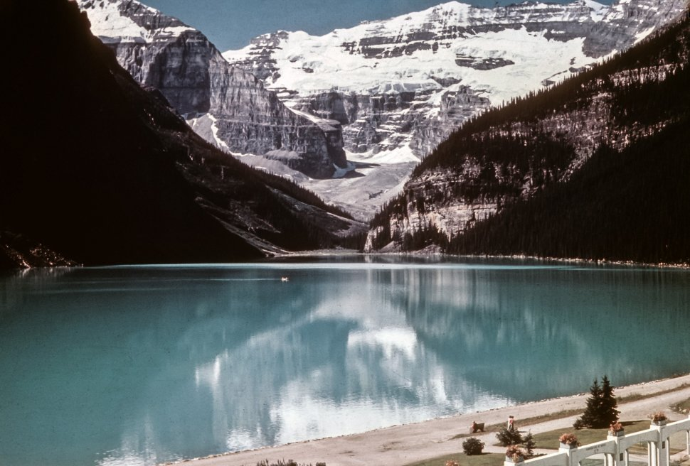 Free image of Lake Louise Chateau view from the shore of snow capped mountains, Canada