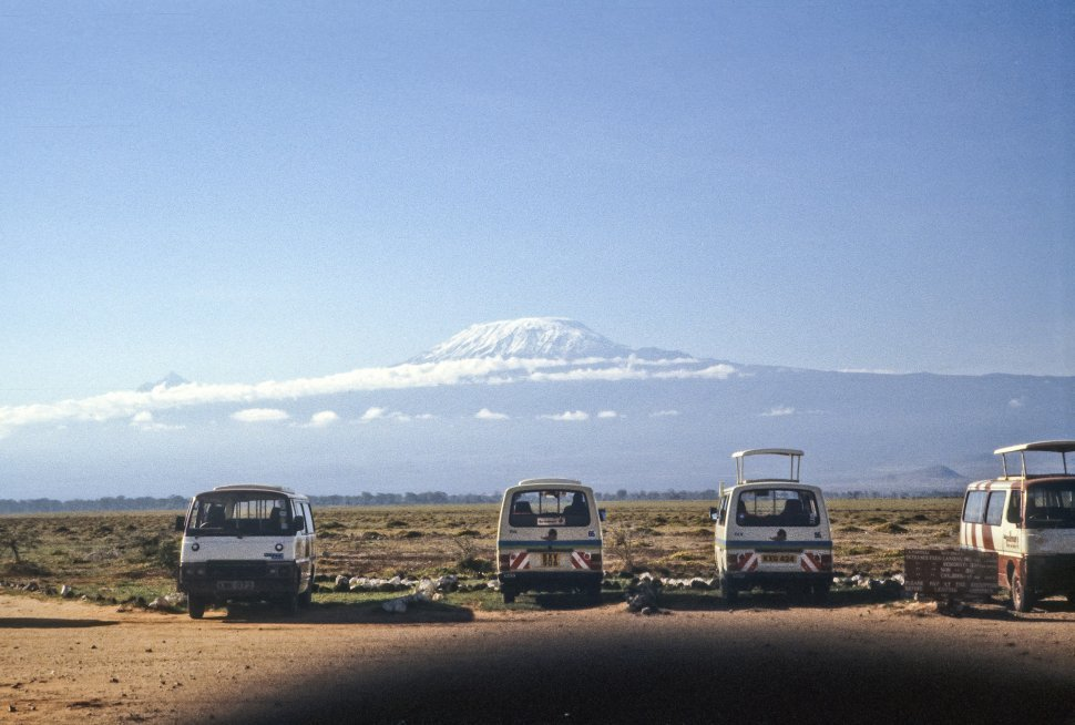 Free image of Tour buses parked in a lot, with Mount Kilimanjaro in the distance, Africa