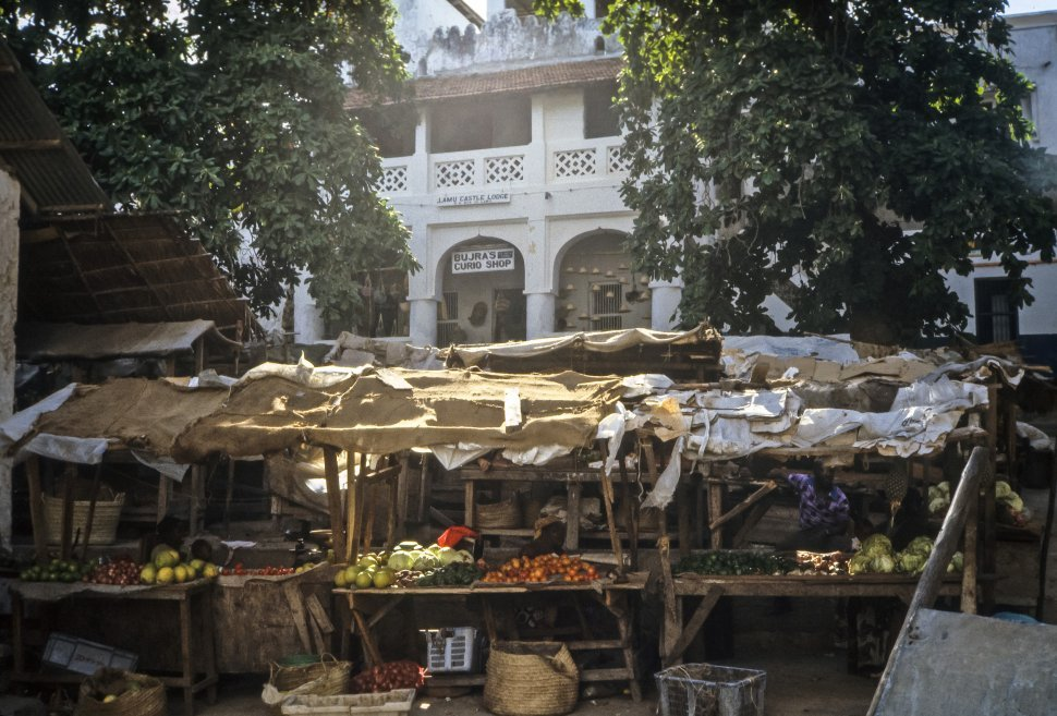 Free image of Men and women selling fruit at the marketplace, Africa