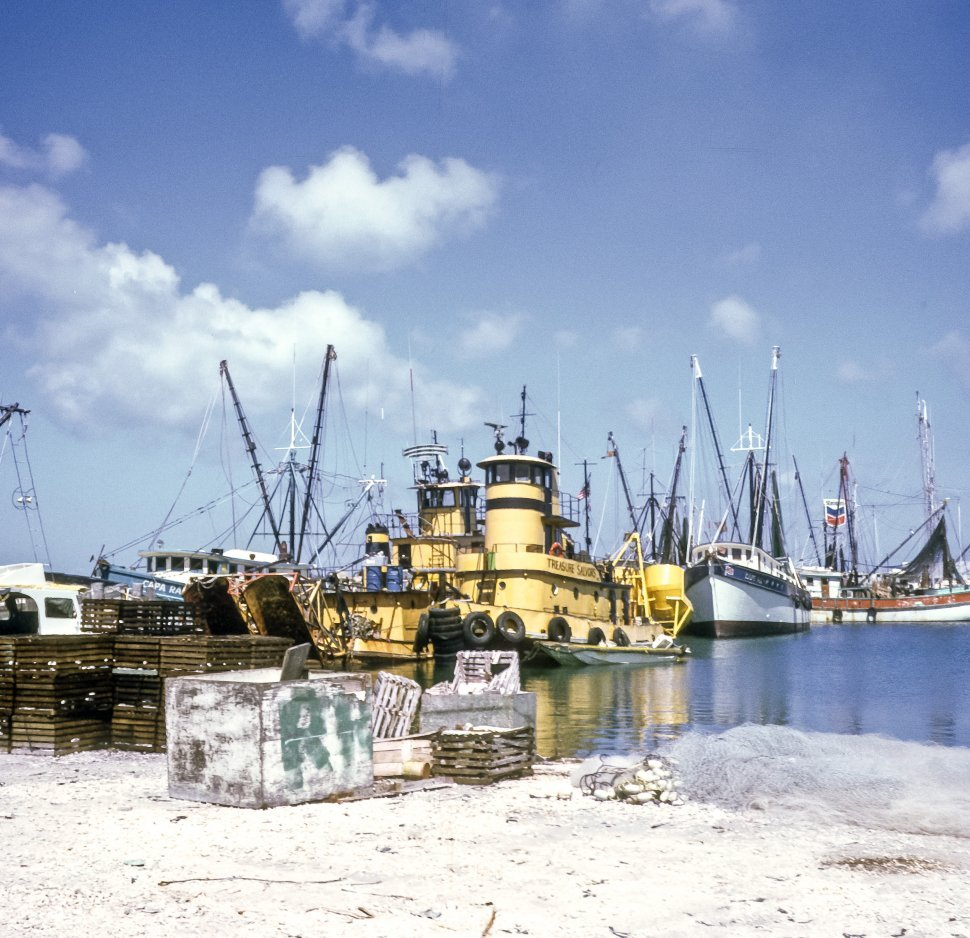 Free image of Tugboats and other small boats floating in the harbor, USA