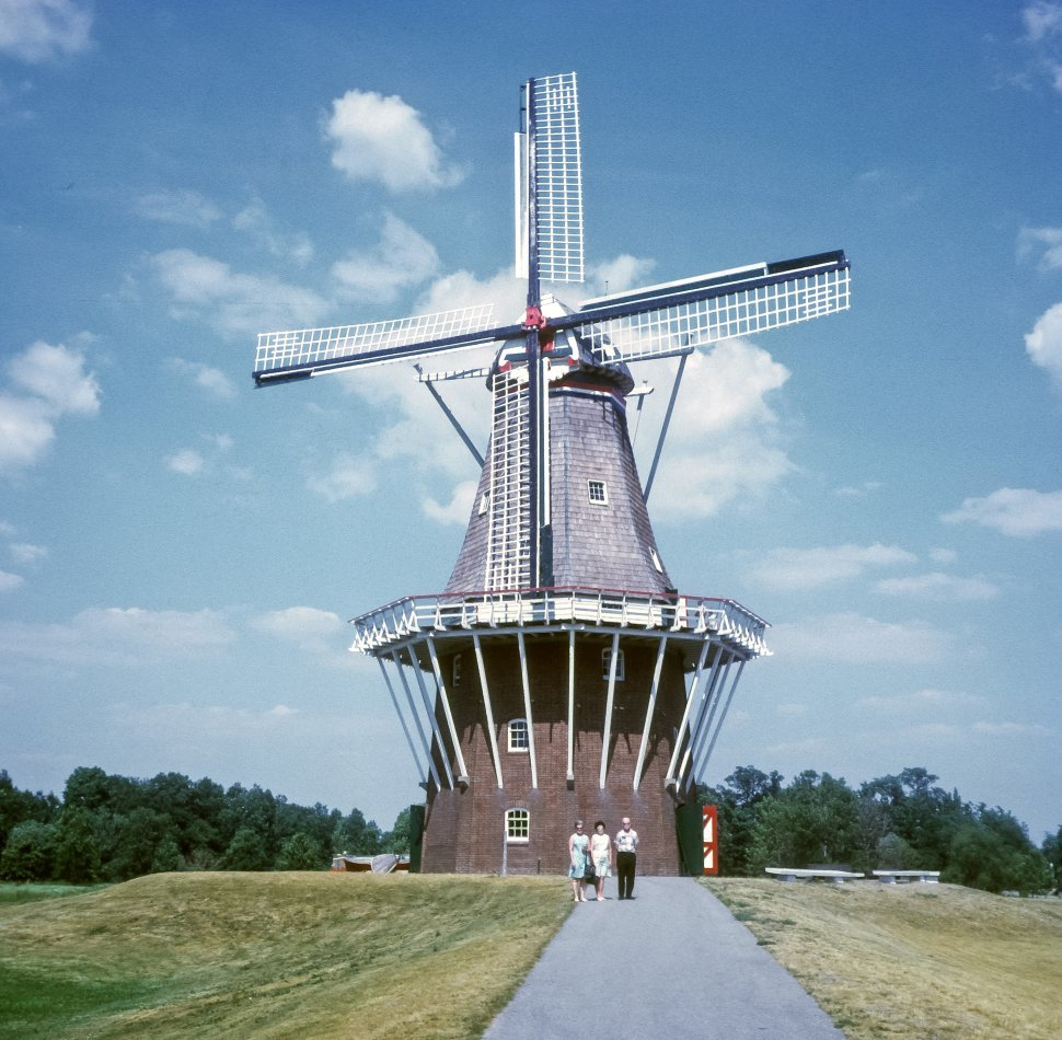Free image of Three people standing in front of the Keukenhof Windmill in the tulip fields, New Zealand