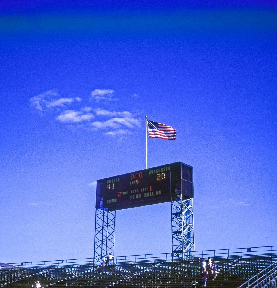 Free image of Flag and and scoreboard for Wisconsin and Purdue football game, USA