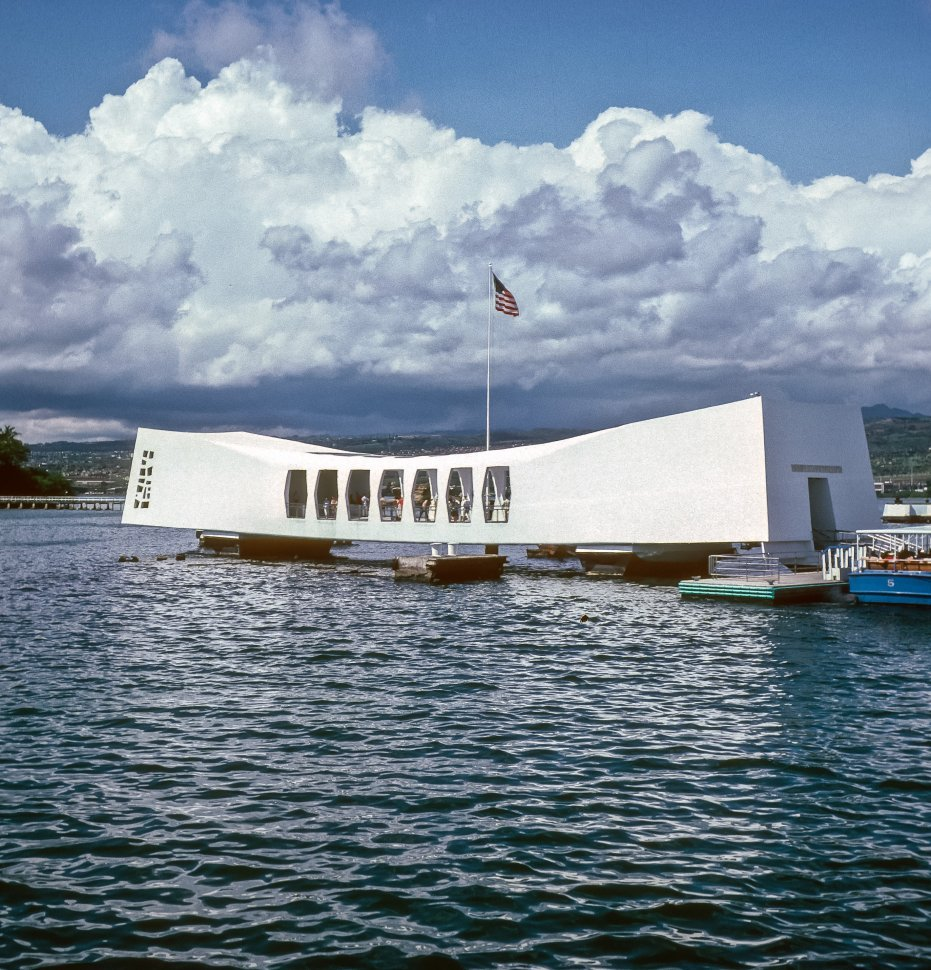 Free image of Futuristic white structure sitting above water on supports. Pearl Harbor Memoria, Hawaii, USA