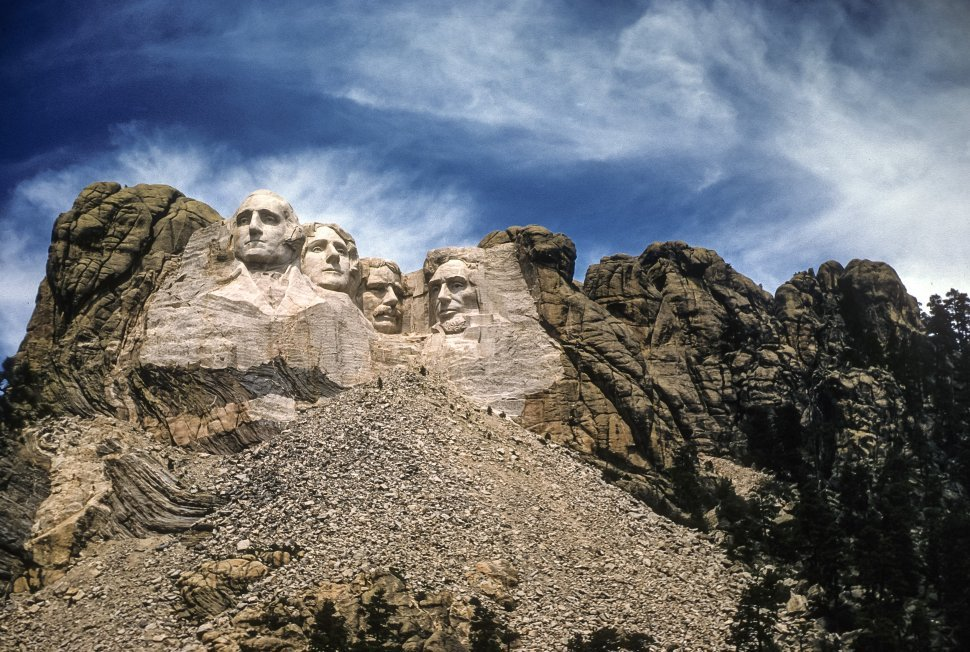 Free image of Mount Rushmore carving of former United States presidents George Washington, Thomas Jefferson, Theodore Roosevelt and Abraham Lincoln, South Dakota, USA
