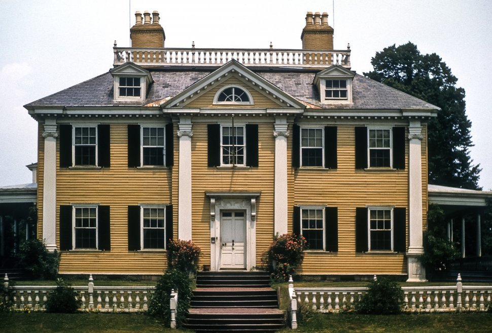 Free image of Facade of a large colonial mansion home and front lawn, USA