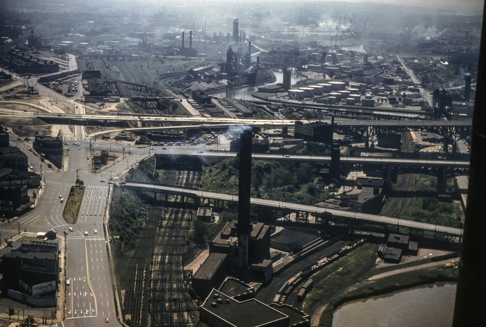 Free image of Aerial view of an industrial factories emitting steam and smoke.