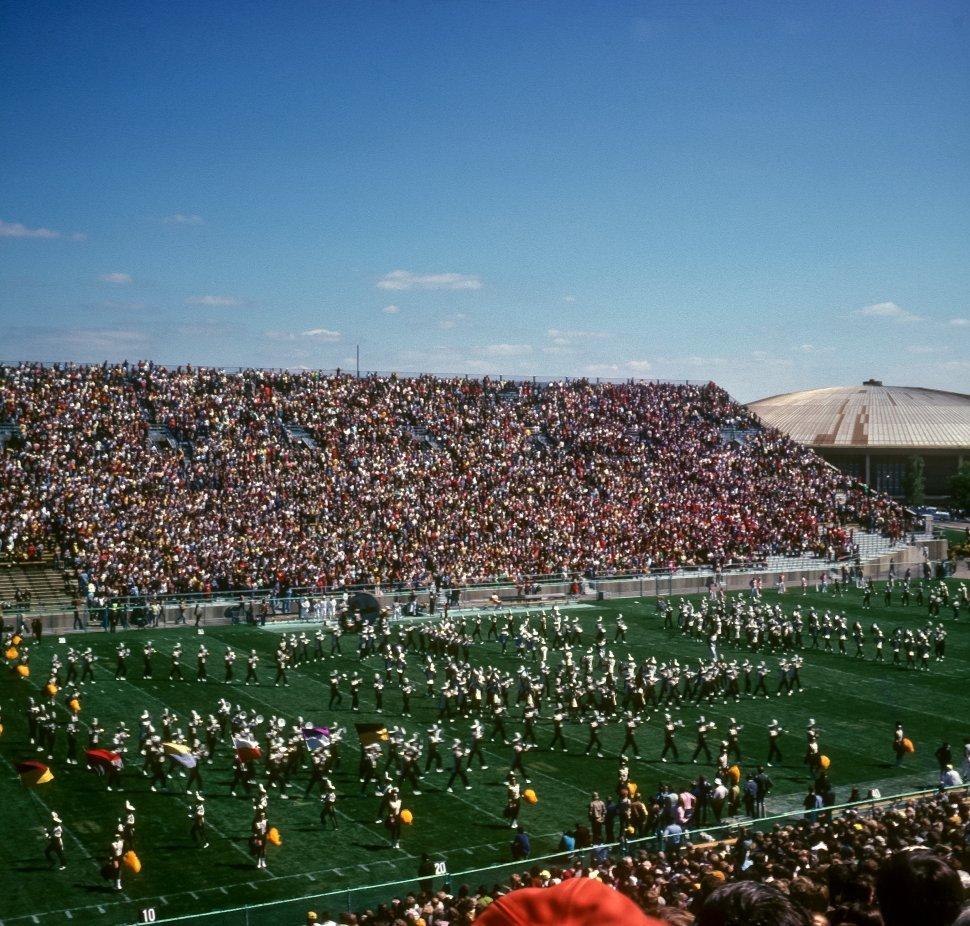 Free image of Aerial view of a marching bacnd on the field of a football field, USA
