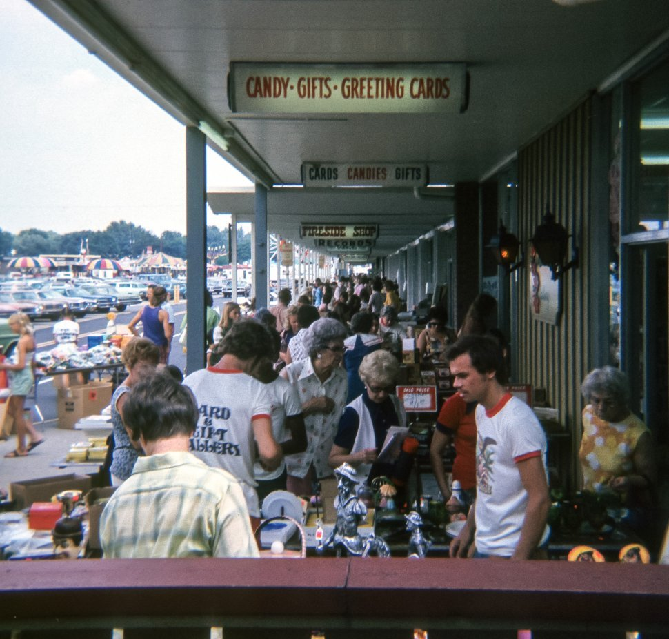 Free image of Large group of customers and vendors in a crowded marketplace, USA