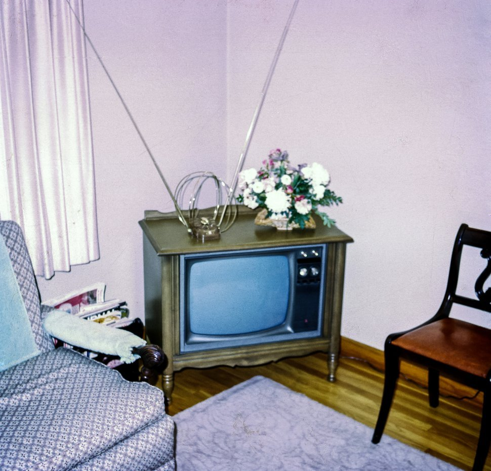 Free image of Vintage television set in a corner next to other furniture, USA