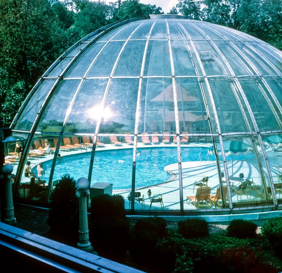 Free image of Tourists under a partial pool dome, USA
