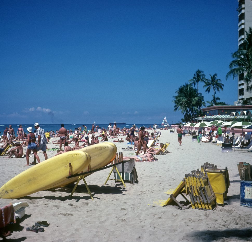Free image of Large group of tourists on a crowded beach, Hawaii, USA