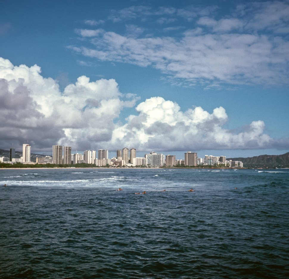Free image of Group of people swimming far out in the water off the beach, Hawaii, USA