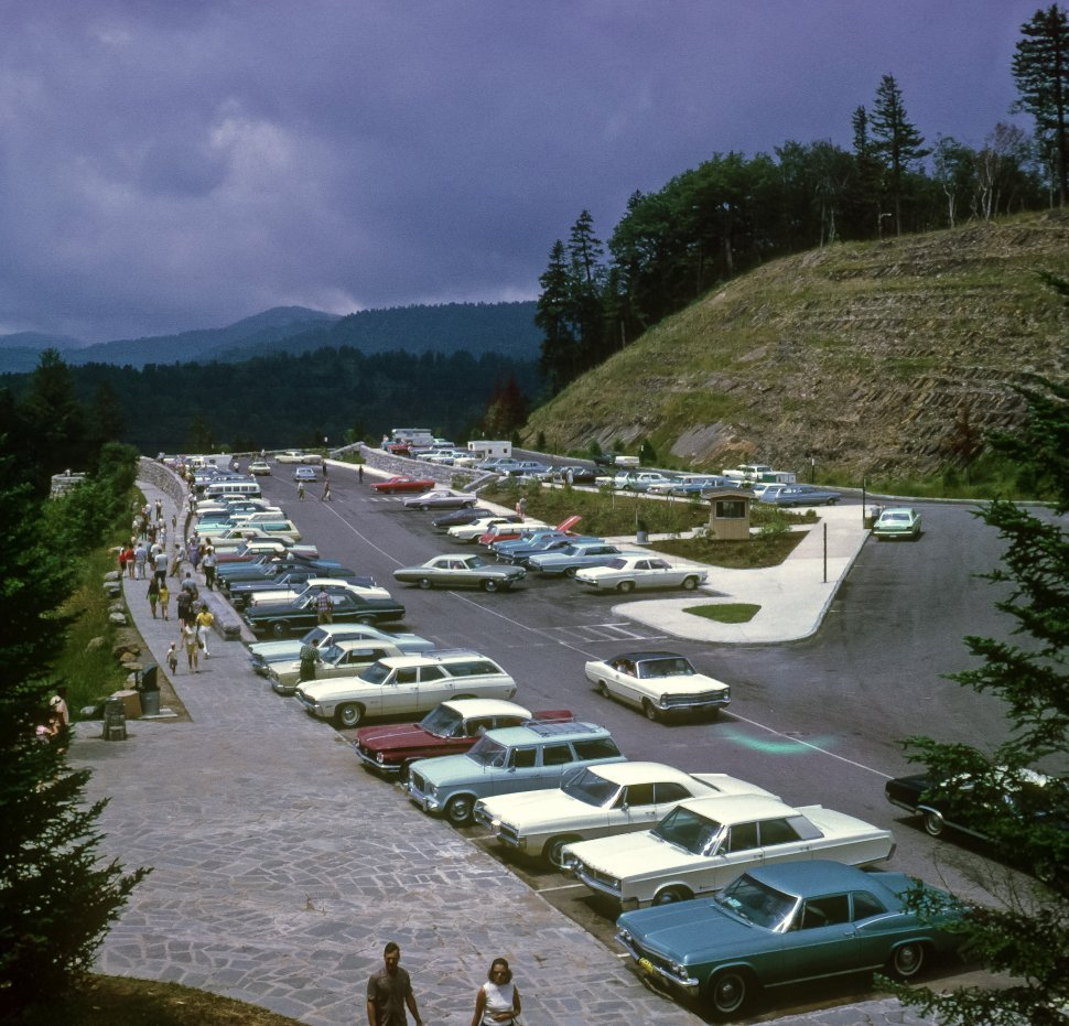 Free image of Tourists and cars in a mountain parking lot and rest stop, USA