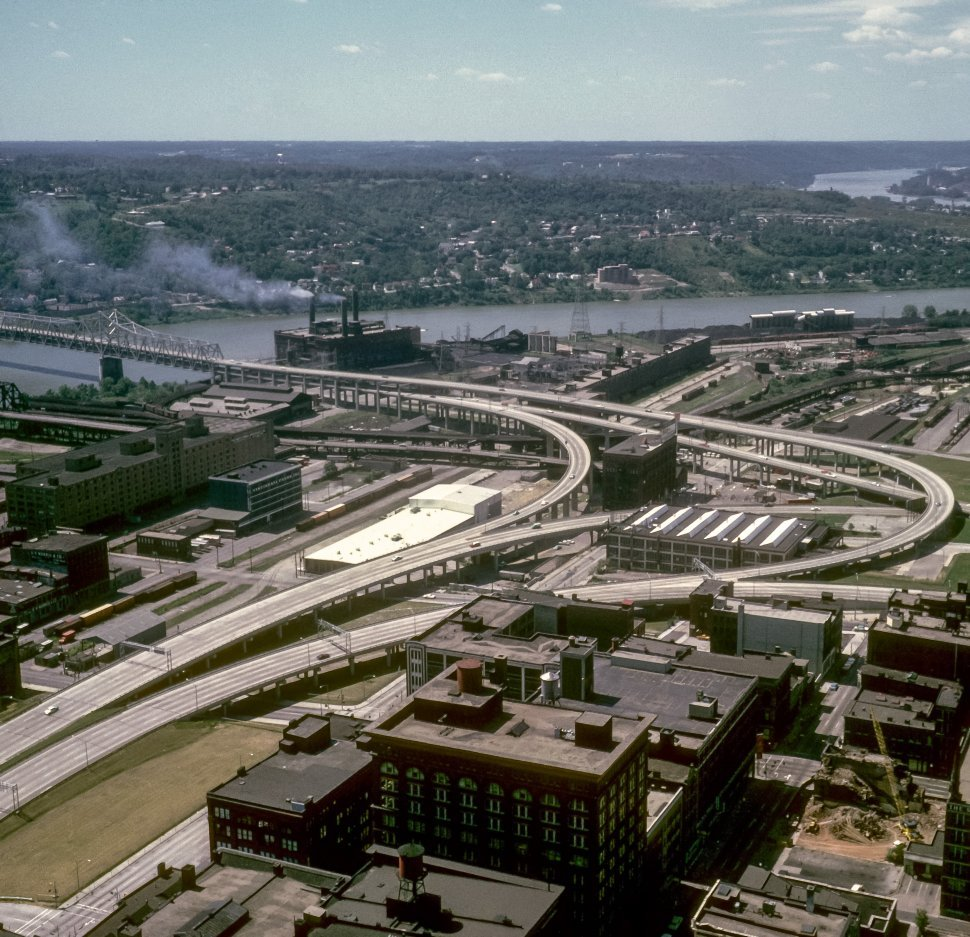 Free image of Aerial view of an industrial park and freeway interchange.