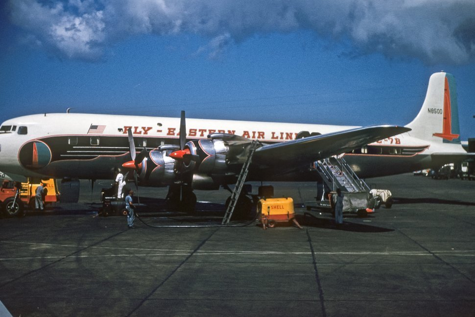 Free image of Crew servicing an Eastern Airlines plane on the tarmac, USA