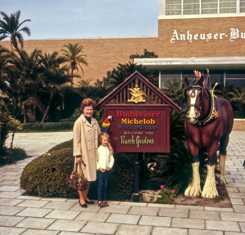 Free image of Anheuser Busch sign and factory with a woman and child posing in front, Tampa, Florida, USA
