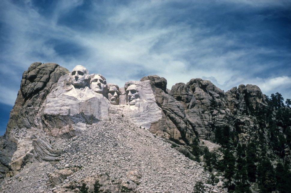 Free image of Stone carving of George Washington, Thomas Jefferson, Theodore Roosevelt and Abraham Lincoln on Mount Rushmore, South Dakota, USA
