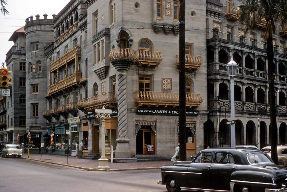 Free image of Cars and people passing the ornate facade of a business on a busy street corner, St. Augustine, Florida, USA