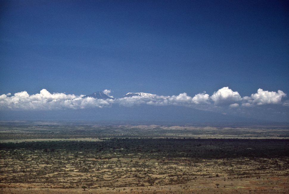 Free image of Mount Kilimanjaro shrouded in clouds in the distance, Tanzania, Africa