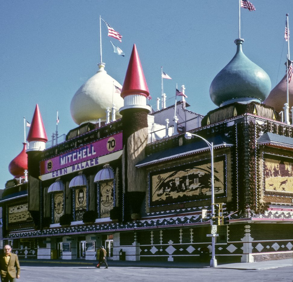 Free image of Man walking in front of the Mitchell Corn Palace facade, South Dakota, USA