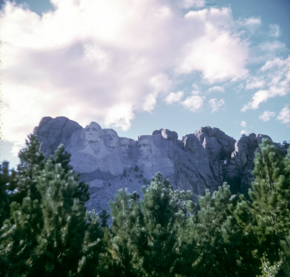 Free image of Carvings of United States presidents George Washington, Thomas Jefferson, Theodore Roosevelt and Abraham Lincoln on Mount Rushmore, South Dakota, USA